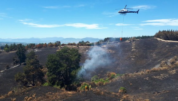 Helicopters with monsoon buckets were be called in to put out hot spots too hot to be pulled out by hand. Credit: Chris Wootton.