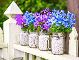 Pint Jar Mugs filled with stones and faux flowersPint Jar Mugs filled with stones and faux flowers