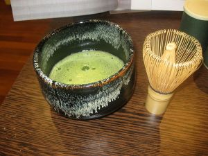 Photo of frothy green tea made by whisking powdered tea and water.