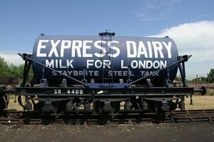 """Rail car for hauling milk with """"Express Dairy - Milk for London"""" written on it."""