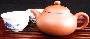 Yixing Teapot and Two Small Cups