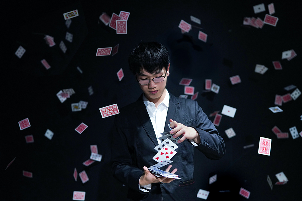 Magician deceiving the brain with a card trick