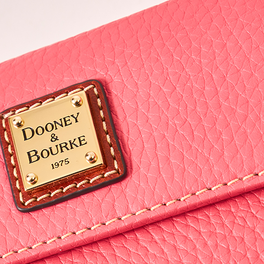 Up-close image of Dooney & Bourke wallet in Bubble Gum.