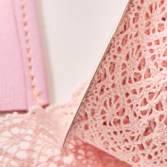 Up-close image of pink lace.