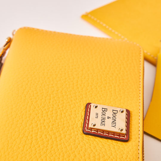 Pebble leather wallet in sunny dandelion yellow.