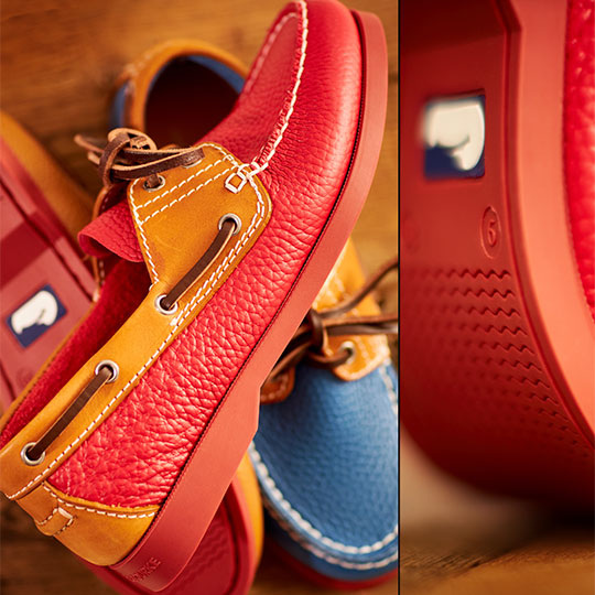 close up of red leather boat shoe