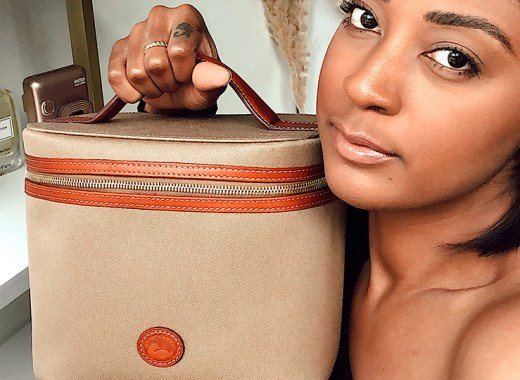 Brittany Turner holding a D&B cosmetics case.