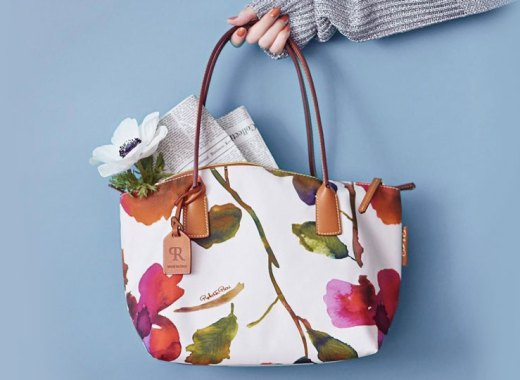 Woman holding a Roberta Pieri tote.