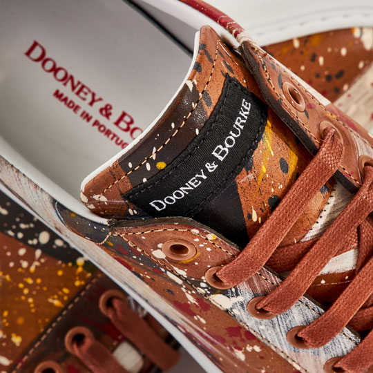 The Dooney & Bourke tongue tag on a pair of Florentine Dipinta Women's Lace Ups.