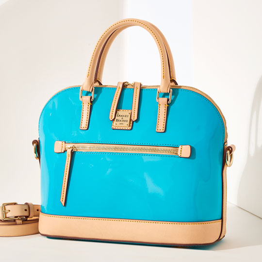 A sky blue patent leather satchel.