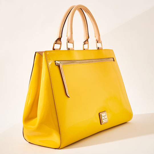 A yellow patent leather satchel.