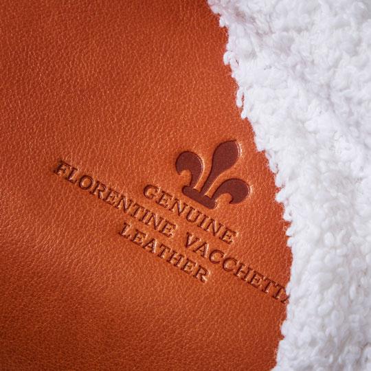 The Genuine Florentine Vacchetta Leather stamp on a Florentine handbag.