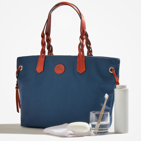 A Nylon Tote is shown with cleaning supplies including a washcloth, toothbrush, distilled water and talc powder.