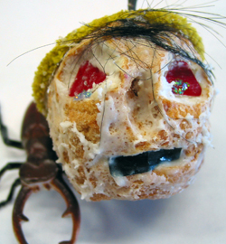 Dried and decorated apple resembling a head.