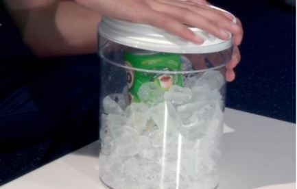 Milo tin surrounded by ice in a larger sealed container