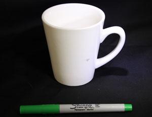 Mug and green marker.