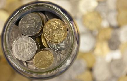 Jar full of Australian coins. ©iStock.com/CraigRJD