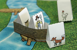 a paper model of a boat with a farmer and a bag of seed on board