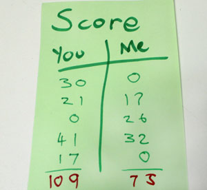 The score sheet - one column adds up to 109, the other adds up to 75.