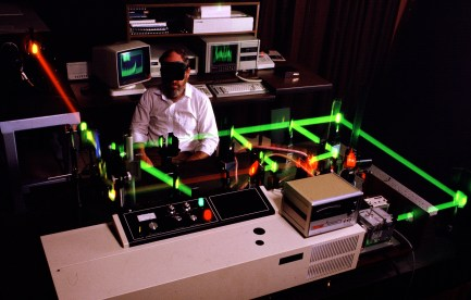 Scientist operating green lasers