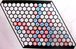 A grid of hexagons. There are lines of red and blue marked hexagons.