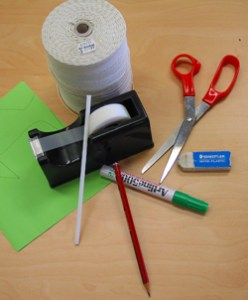 green paper, stick ape, straws, scissors, pencil, eraser, marker.