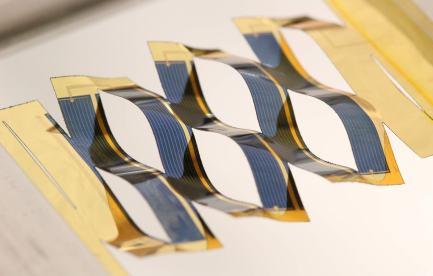 A solar panel cut into a lattice shape.
