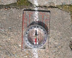 A compass on a chalk line.