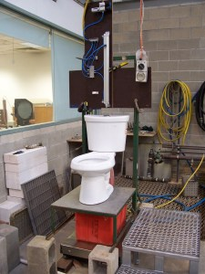 A toilet surrounded by scientific equipment.