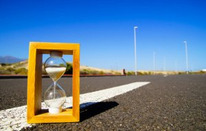 A sand timer on a road.