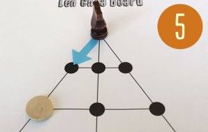 A big piede on a game board. An arrow indicates movement along a line.