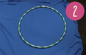 A hula hoop placed on a piece of blue fabric.