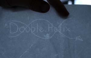 A sheet of paper, with a logo shining thorugh it from behind.