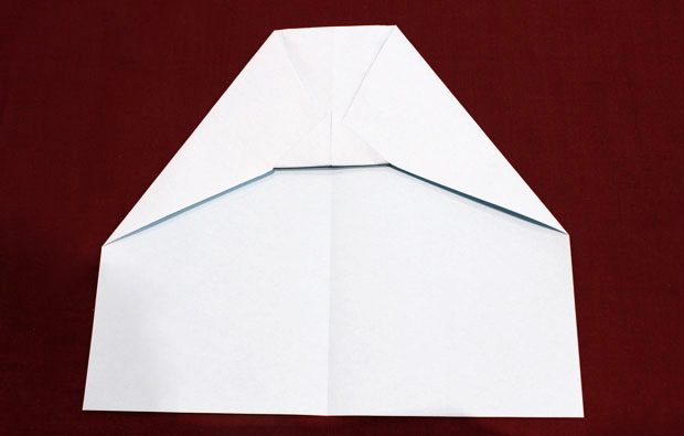 A folded piece of white paper.