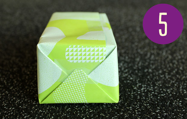 Box wrapped in green paper.