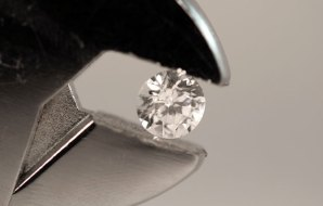 Diamond held by pliers.