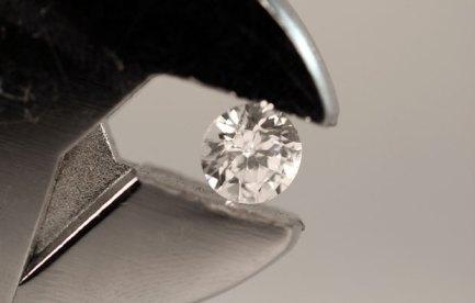 Diamond held by pliers.