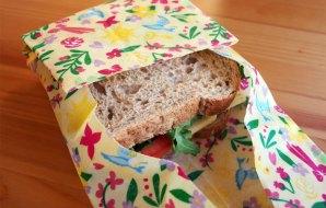 Sandwich wrapped in a wax cloth wrap.