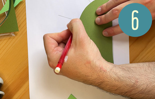 Marking the measured lines onto the coloured paper semi-circle.