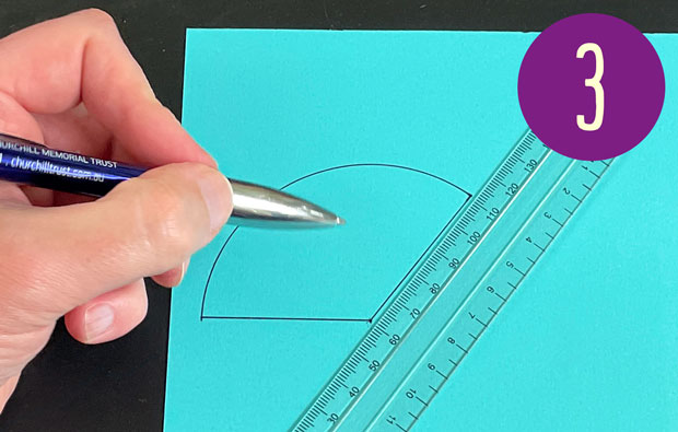Ruling an angle onto the card using the protractor.
