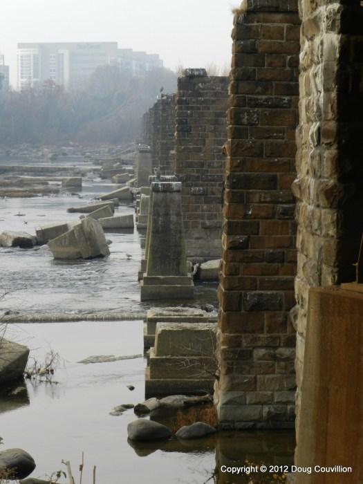 photograph of deteriorating brick and concreate bridge pilings