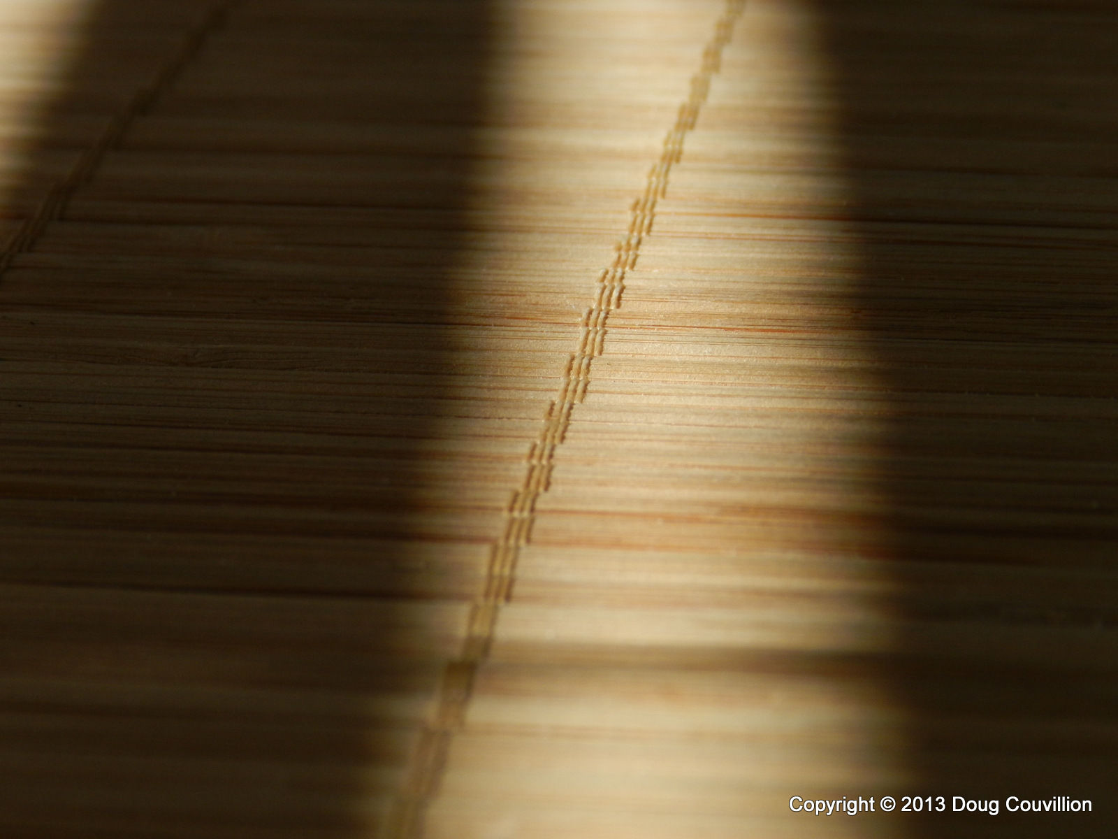 photograph of crossing lines of light and wicker