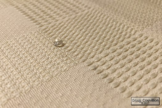 photograph of a drop of water on cloth by Doug Couvillion