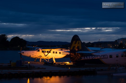 Photograph of a float plane tied up at dock at night by Doug Couvillion