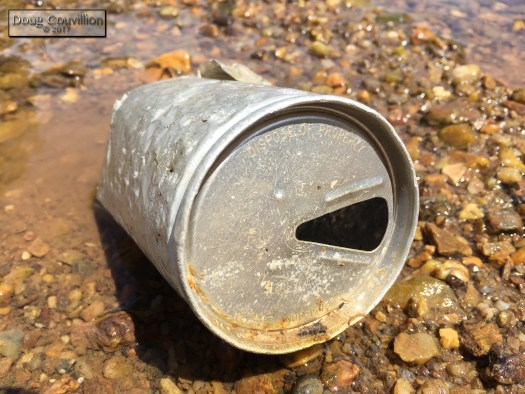 Photograph of a can in the Rivanna River by Doug Couvillion