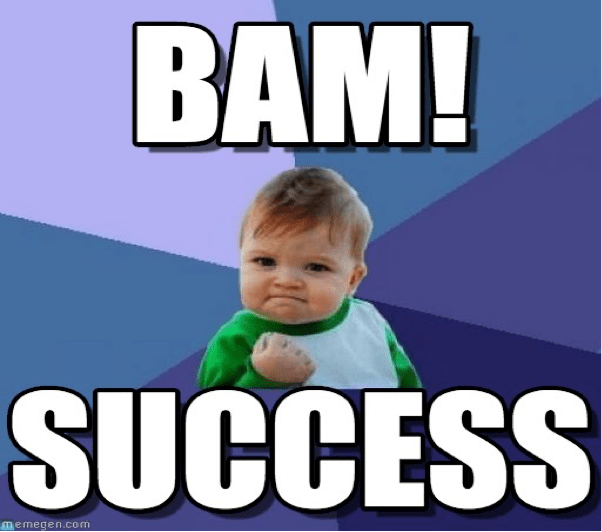 baby has a clenched fist with text saying bam success