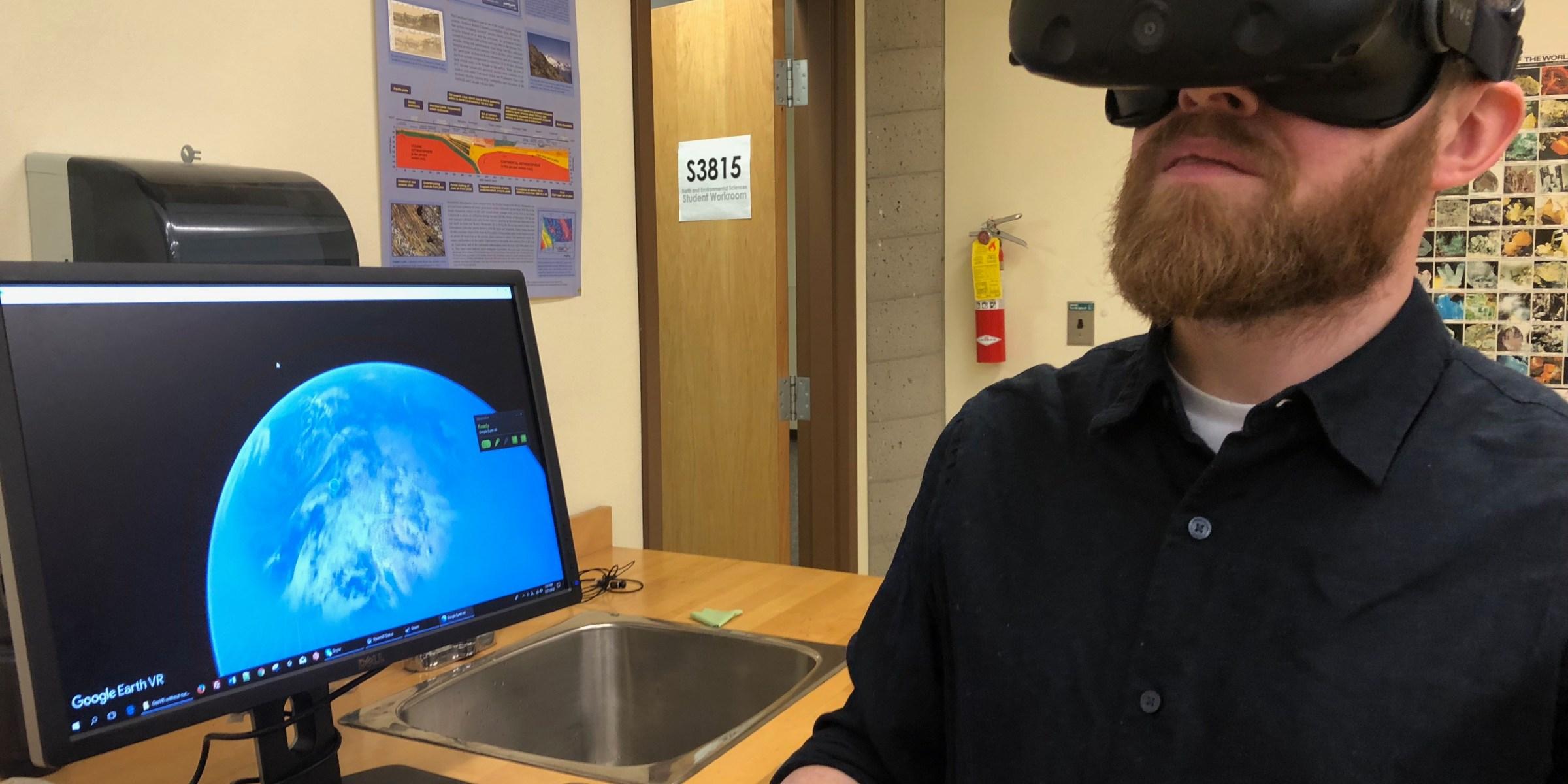 Derek Turner uses VR glasses