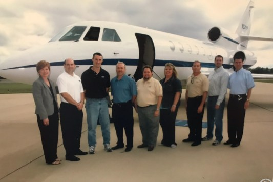 Amy and others with the Phifer corporate jet, at shade training in Alabama.