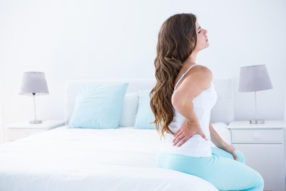 Sente dor forte na coluna? Veja 5 possíveis causas do problema