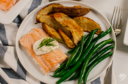Salmon with Creamy Tarragon Sauce over Crispy Potatoes